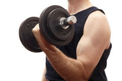 Formation de muscle avec le poids Photographie stock libre de droits