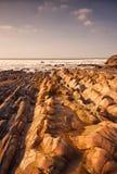 Formation de roche douce de grès, plage de Crooklets, Bude les Cornouailles photo stock