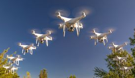 Formation of Drones Swarm in the Blue Sky. Formation of Drones Swarm in a Clear Blue Sky stock photos