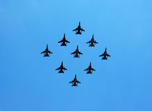 Formation of fighter planes. Fighter planes in formation with a clear sky background Stock Photography