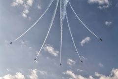 Formation of five airplanes in the sky at an air show. Going different ways Royalty Free Stock Photos