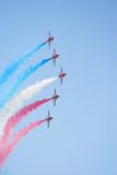Formation flight Red Arrows. Formation flight of the Royal Air Force Aerobatics team the Red Arrows royalty free stock images