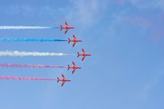 Formation flight Red Arrows. Formation flight of the Royal Air Force Aerobatics team the Red Arrows stock photo