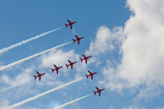 Formation flying. Precision flying maneuver by an aerobatic display team Stock Images