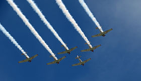 Formation flying at EAA AirVenture at Oshkosh. The Geico Skytypers Airshow Team flying in formation at the 2016 EAA AirVenture Airshow in Oshkosh, Wisconsin Royalty Free Stock Photography