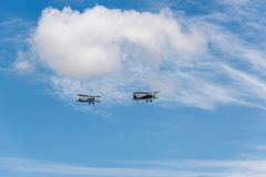 Formation flying of two old biplane aircrafts during air show. Madrid, Spain - June 3, 2018:  Formation flying of Polikarpov Po 2 and De Havilland DH-60 during Royalty Free Stock Images
