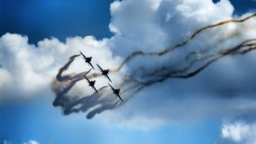 Formation of four jet aircraft in aerobatic team. stock photo