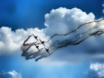 Formation of four jet aircraft in aerobatic team. royalty free stock photo