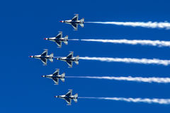 Formation of jet aircrafts flies as a team in blue sky. Formation of jet aircrafts flies as a team in blue sky with white smoke trails Stock Photography