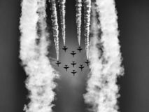 Formation of military training jet aircraft - aerobatic team. Aerobatic team on clear blue sky. Hawk training aircraft in arrow formation making a loop stock photos