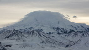 The formation and movement of clouds above the volcano Elbrus in the Caucasus Mountains in winter. stock video footage