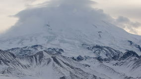 The formation and movement of clouds above the volcano Elbrus in the Caucasus Mountains in winter. stock video