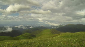 The formation and movement of clouds over the summer slopes of Adygea Bolshoy Thach and the Caucasus Mountains stock footage