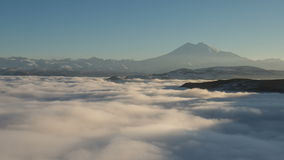 The formation and movements of clouds up to the steep slopes of the mountains of Central Caucasus peaks. stock footage