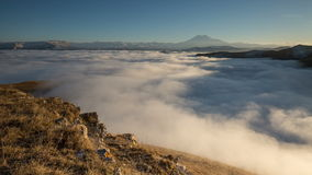 The formation and movements of clouds up to the steep slopes of the  mountains of Central Caucasus peaks. Russia, timelapse. The formation and movements of stock video