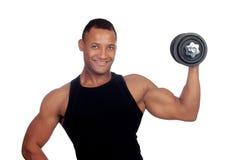 Formation musculeuse belle d'homme avec des haltères Photographie stock libre de droits
