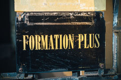 Formation Plus, More Training sign iwth golden letters Stock Photography