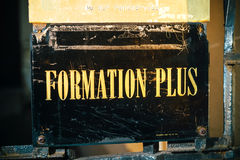 Formation Plus, More Training sign iwth golden letters Royalty Free Stock Images