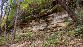 Formation of rock layers on side of hill royalty free stock images