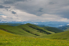 The formation of storm clouds over the mountains. Stock Photos
