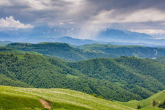 The formation of storm clouds over the mountains. Royalty Free Stock Image