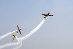 Formation of YAK 52 airplanes at Romanian Air Show. YAK 52 romanian formation, intitled Iacarii Acrobati performing in the air Royalty Free Stock Images