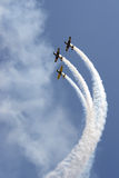 Formation of YAK 52 airplanes at Romanian Air Show. YAK 52 romanian formation, intitled Iacarii Acrobati performing in the air at Romanian Air Show Stock Photo