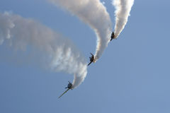 Formation of YAK 52 airplanes at Romanian Air Show. YAK 52 romanian formation, intitled Iacarii Acrobati performing in the air at Romanian Air Show Stock Photos