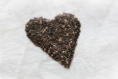 Formazione del cuore di semi di chia Fotografie Stock Libere da Diritti