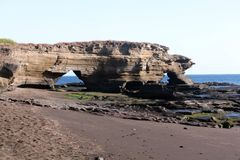 Formazione rocciosa Egas Port (Puerto Egas), Santiago Island (isole Galapagos, Ecuador) Immagine Stock