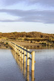 Formby. Flooded fence at Formy sands Royalty Free Stock Image