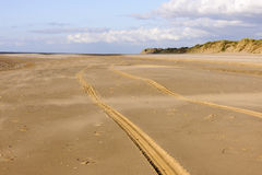 Formby. Tyre tracks in sand at Formby sands Royalty Free Stock Photography