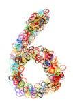 Forme élastique colorée numéro six de bandes élastiques Photos stock