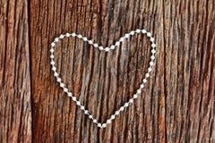 Forme argentée de coeur de bracelet Photos libres de droits