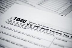Forme in bianco di imposta sul reddito. Forma di ritorno 1040 dell'imposta sul reddito delle persone fisiche dell'americano. Immagine Stock