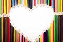 Forme colorée de coeur de crayons Image libre de droits