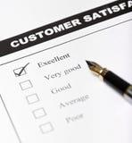 Forme d'enquête de satisfaction du client - plan rapproché Photo libre de droits