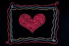 Forme de coeur à l'intérieur d'un cadre Images libres de droits