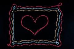 Forme de coeur à l'intérieur d'un cadre Photo stock