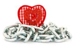 Forme de coeur avec des chaînes sur le blanc Photo stock