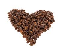 Forme de coeur avec des grains de café Photographie stock