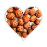 Forme de coeur avec des noix à l'intérieur Image libre de droits