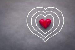 Forme de coeur avec le cercle blanc de dessin Photographie stock libre de droits