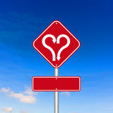 Forme de coeur avec le panneau routier de flèche Images libres de droits