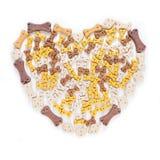 Forme de coeur d'aliment pour animaux familiers Image stock