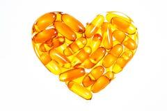 Forme de coeur d'huile de poisson, capsule molle, Omega, isolat de supplément Photographie stock libre de droits