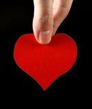 Forme de coeur dans la main Image stock