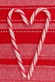 Forme de coeur de cannes de sucrerie de décoration de Noël   Photos libres de droits