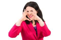 Forme de coeur de femme devant le sourire Photos stock