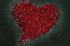 Forme de coeur de la texture de la graine de grenade Images libres de droits